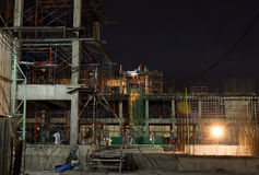 Construction site with Worker working at night Royalty Free Stock Image