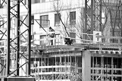 Construction site workers.black and white Royalty Free Stock Photos