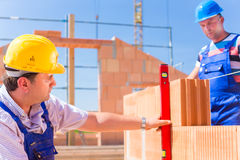 Construction site workers checking  building shell Stock Images