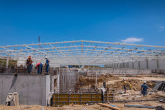Construction site with workers copy space Royalty Free Stock Photography