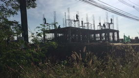 Construction site workers time lapse in thailand. Silhouette stock video
