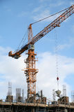 A construction site with a yellow crane Royalty Free Stock Photo