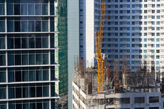 Construction Site. Yellow construction crane on building site. Another building is about to rise in the central business district in Ortigas Center, Philippines Stock Image