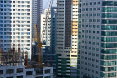 Construction Site. Yellow construction crane on building site. Another building is about to rise in the central business district in Ortigas Center, Philippines Royalty Free Stock Photo