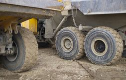 Truck lorry tipper yellow big wheels equipment construction site working. Construction site yellow lorry truck wheels dirt royalty free stock photos