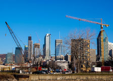 Construction sites with cranes and highrises. Cranes among highrise buildings in a modern city royalty free stock image