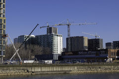 Construction sites with cranes and highrises Royalty Free Stock Photos