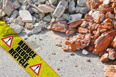 Construction solid waste management in building activity - concept image with text Reduce Reuse Recycle written on a yellow stripe.  royalty free stock image