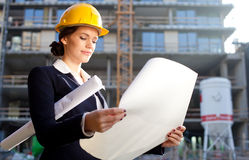 Construction specialist looking at blueprints Royalty Free Stock Images