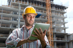 Construction specialist using a tablet computer. Stock Photos
