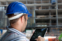 Construction specialist using a tablet computer.