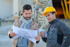 Construction specialist and worker outdoors Stock Photos