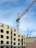 Construction of a standard brick apartment building in the city. Of Yaroslavl, a tower crane on the construction site Stock Photos