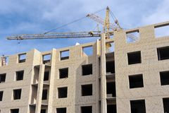 Construction of a standard brick apartment building in the city of Yaroslavl. A tower crane on the construction site Stock Photography