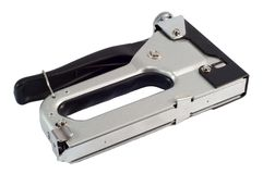 Construction Stapler Isolated. On a white background. Closeup stock photography