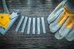 Construction stapler metal staples protective gloves.  royalty free stock image