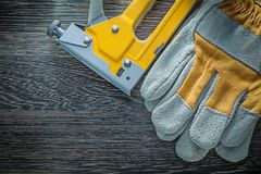 Construction stapler safety gloves top view.  stock photos