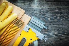 Construction stapler staples wooden meter planks protective glov. Es stock photography