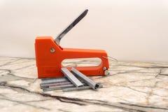 Construction stapler staples wooden planks fastening stapl.  royalty free stock photos