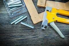 Construction stapler staples wooden planks top view.  stock photo