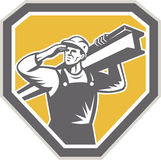 Construction Steel Worker Carrying I-Beam Retro. Illustration of construction steel worker carrying i-beam girder viewed from front saluting set inside shield Stock Images