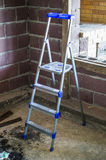 The construction step-ladder indoors Royalty Free Stock Images