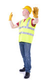 Construction stop. Construction worker gesturing stop for traffic to pass  on white Royalty Free Stock Image
