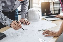 Construction and structure concept of Engineer or architect meeting for project working with partner and engineering tools on stock image