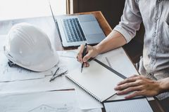 Construction and structure concept of engineer or architect working on blueprint, Engineer working with engineering tools for stock image