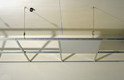 Construction of the structure of a suspended ceiling. With plasterboard stock images