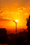 Construction on sunset. Construction cranes silhouette at sunrise Stock Images