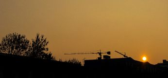 Construction of the sunset - silhouette.  Stock Images