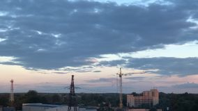 Construction at sunset time lapse beautiful clouds town stock video footage