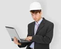 Construction superintendent with computer in hands Stock Photo