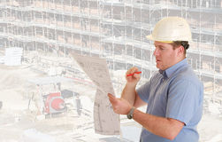 Construction supervisor. In safety helmet   in front of construction site Royalty Free Stock Photos