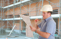 Construction supervisor. In safety helmet   in front of construction site Stock Image