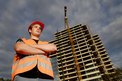 Construction supervisor. In safety helmet and reflex vest in front of construction site Stock Images