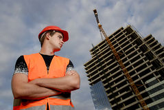 Construction supervisor. In safety helmet and reflex vest in front of construction site Stock Photos