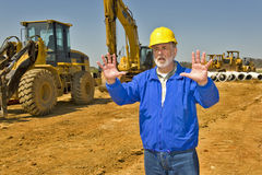 Construction Supervisor Directing Traffice. Horizontal shot of supervisor on work site directing traffic Royalty Free Stock Image