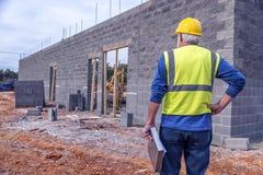 Construction Supervisor Looks Over Job Site Stock Photos