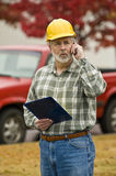 Construction Supervisor Makes Phone Call Royalty Free Stock Photos
