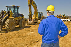 Construction Supervisor Overlooking Job Site.  Royalty Free Stock Photo