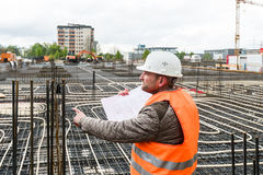 Construction supervisor with plan on site Royalty Free Stock Photography