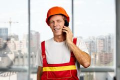 Construction supervisor talking on cell phone. Royalty Free Stock Photography