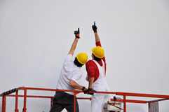 Construction supervisors. Image of construction supervisors on a mechanical lift Royalty Free Stock Images