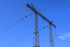 Construction of a support and wires of a high-voltage power line close-up against a blue sky royalty free stock image