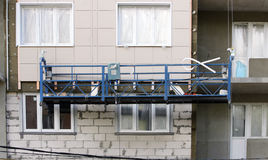 Construction suspended cradle without workers on a newly built high-rise building Stock Image