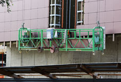 Construction suspended cradle without workers on a newly built high-rise building Stock Images