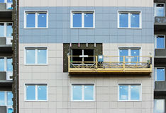 Construction suspended cradle without workers on a newly built high-rise building Royalty Free Stock Photography