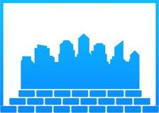 Construction symbol with city and bricks Royalty Free Stock Photos